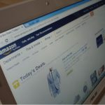 A laptop displays the online retailer Amazon's home page