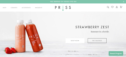 Press London homepage screenshot - a bottle of juice leaning against another